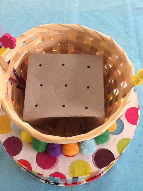 Box with holes inside basket