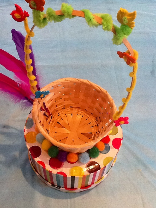 Hat with feathers,pompoms and pipe cleaners