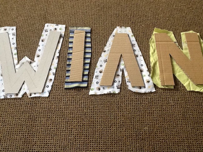 Fabric and cardboard letters